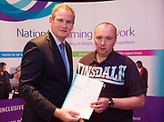 Sean Kyne TD Minister of State for Community Affairs, Natural Resources and Digital Development, presenting certification  in Employer Based Training  to Marcus Connolly QQI level 4 in IT skills  workplace safety and Work Experience. Photo:Andrew Downes, xposure .