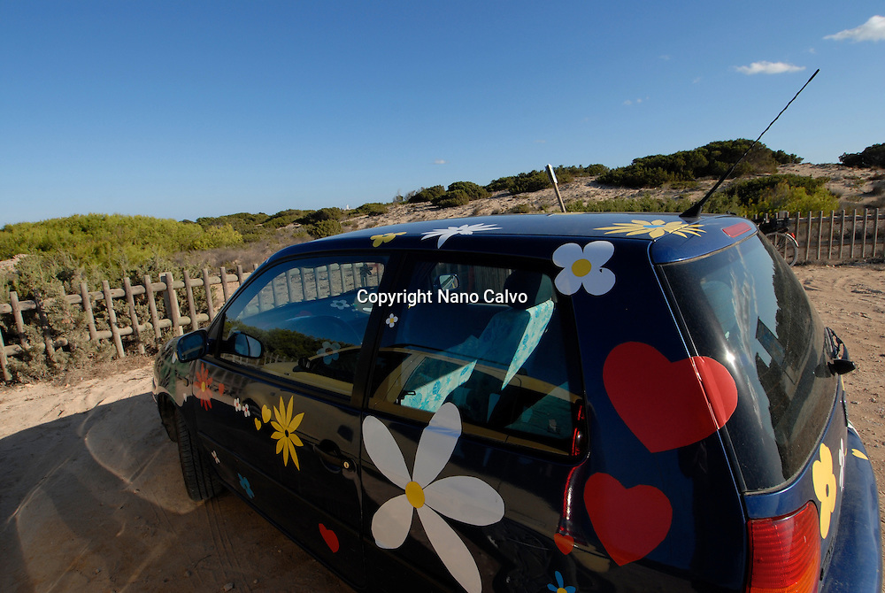 Colorful and flower decorated car in Levante beach - Playa de Llevant -, Formentera