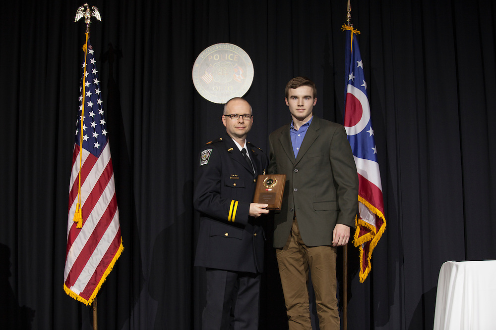 Capt. Kapple poses for a photo with Joe Kelly, a student who saved the life of a student he lived next to in their residence hall, at the Badge Pinning and Employee Recognition Ceremony on Monday, February 8, 2016. The award given to Kelly is typically given to an officer. Photo by Kaitlin Owens