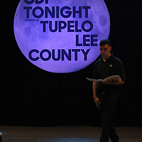 Adam Robison | BUT AT PHOTOS.DJOURNAL.COM<br /> Hunter Aycock, director of business development with CDF, walks the stage before the CDF Annual meeting gets underway at the BancorpSouth Arena Thursday night in Tupelo.