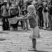 Another street performer outside Faneuil Hall in Boston.  In this case Brent McCoy (BrentMcCoy.com) was performing and asked for a young assistant from the audience.  This little girl was perfect!  Here you can see her trying to catch a ball in his hard hat.