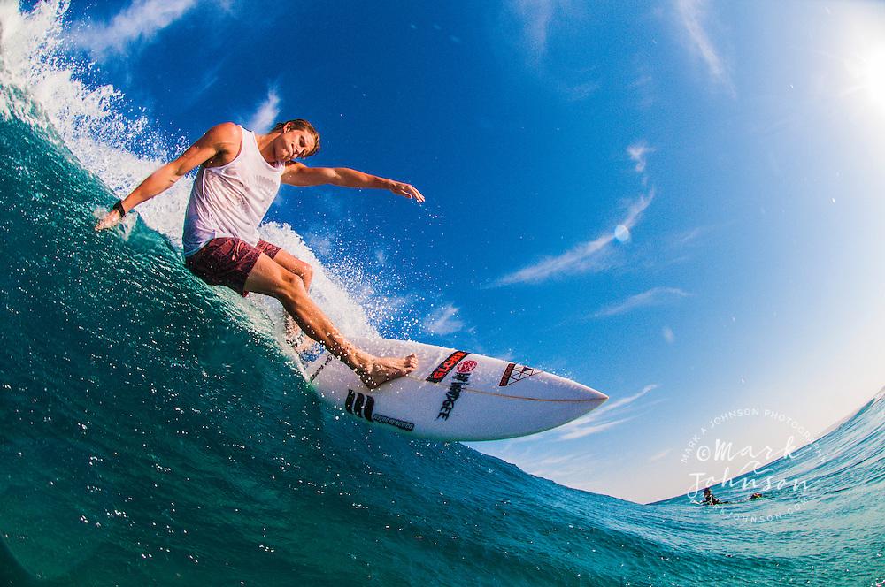 Surfing at Main Beach, N. Stradbroke Island, Queensland, Australia
