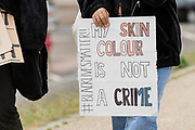 Lady holding sign, 'My Skin Colour is Not A Crime'  during the Black Lives Matter protest in Caerphilly, Wales on 6 June 2020.