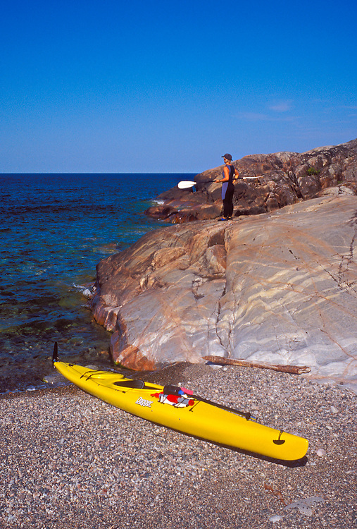 A sea kayaker explores granite outcroppings in Pukaskwa National Park near White River, Ontario.
