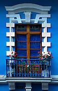Colorful restored architecture in the historic colonial center of Quito, Ecuador.