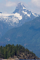 The large Mount Denman massif in the British Columbia Coast Range looms over Desolation Sound.  Desolation Sound, British Columbia, Canada.