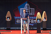 Aug 3, 2019; Canton, OH, USA; Chris Berman emcees the Pro Football Hall of Fame Enshrinement at Tom Benson Hall of Fame Stadium. (Robin Alam/Image of Sport)