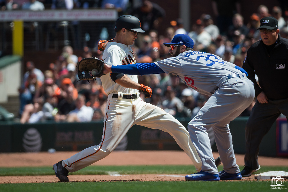 Los Angeles Dodgers first baseman Scott Van Slyke (33) nearly tags San Francisco Giants second baseman Kelby Tomlinson (37) out during a pickoff attempt at first base at AT&T Park in San Francisco, California, on April 27, 2017. (Stan Olszewski/Special to S.F. Examiner)