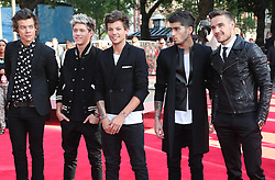 One Direction arriving for the world premiere of their film One Direction: This Is Us,Tuesday, 20th August 2013. Picture by Stephen Lock / i-Images