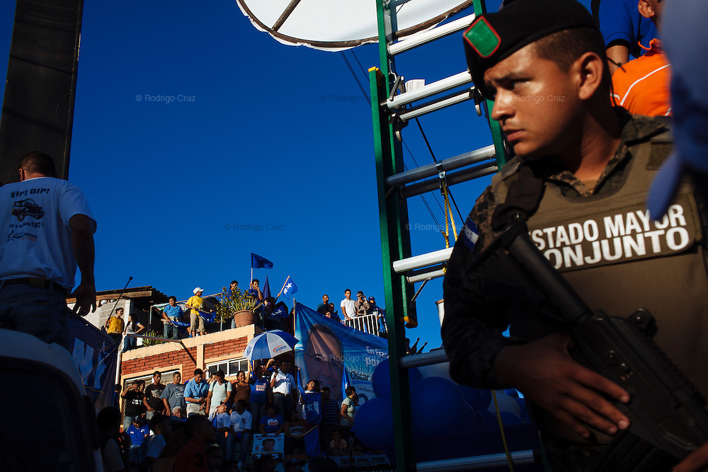 TEGUCIGALPA, HONDURAS - NOVEMBER 12, 2013: A soldier guards the rally of Juan Orlando Hernandez, presidential candidate for the National Party in the Torocagua neighborhood of Tegucigalpa City. Honduras will hold general elections on November 24. CREDIT: Rodrigo Cruz for The New York Times