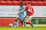 Forest Green Rovers Udoka Godwin-Malife(22) takes on Charlton Athletics Alfie Doughty(45) during the EFL Cup match between Charlton Athletic and Forest Green Rovers at The Valley, London, England on 13 August 2019.