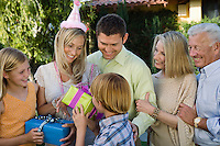 Mid-adult woman receiving birthday presents