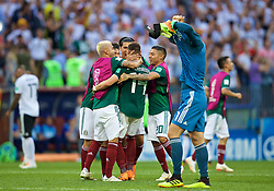 MOSCOW, RUSSIA - Sunday, June 17, 2018: Mexico players celebrate their side's 1-0 victory as Germany's goalkeeper Manuel Neuer pulls his shirt off in dejection during the FIFA World Cup Russia 2018 Group F match between Germany and Mexico at the Luzhniki Stadium. (Pic by David Rawcliffe/Propaganda)
