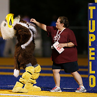 Thomas Wells | Buy at PHOTOS.DJOURNAL.COM<br /> Anthony Staten can't use to hands while dressed up in the Horn Lake mascot so he gets some help with popcorn from Horn Lake teacher Mary Zluticky before their game against Tupelo Friday.