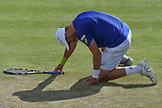 Steve Johnson (USA) slips after a light shower during the semi-finals of Aegon Open at the Nottingham Tennis Centre, Nottingham, United Kingdom on 24 June 2016. Photo by Martin Cole.