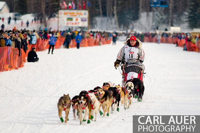 05 March 2006: Willow, Alaska - After 2 second place finishes, Ramy Brooks heads out for Nome in search of his first victory during the official restart of the 2006 Iditarod on Willow Lake in Willow, Alaska