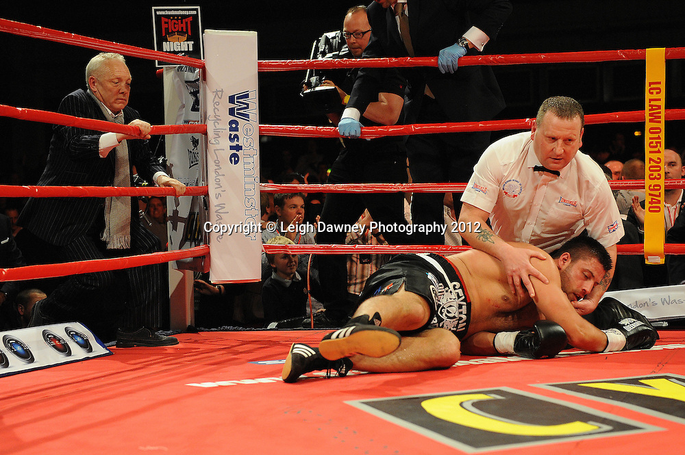 David Price defeats Sam Sexton (pictured after being knocked down) in a 12x3 contest to claim the British & Commonwealth, Heavyweight Title at the Aintree Equestrian Centre, Liverpool on the 19th May 2012. Frank Maloney Promotions © Leigh Dawney Photography 2012.