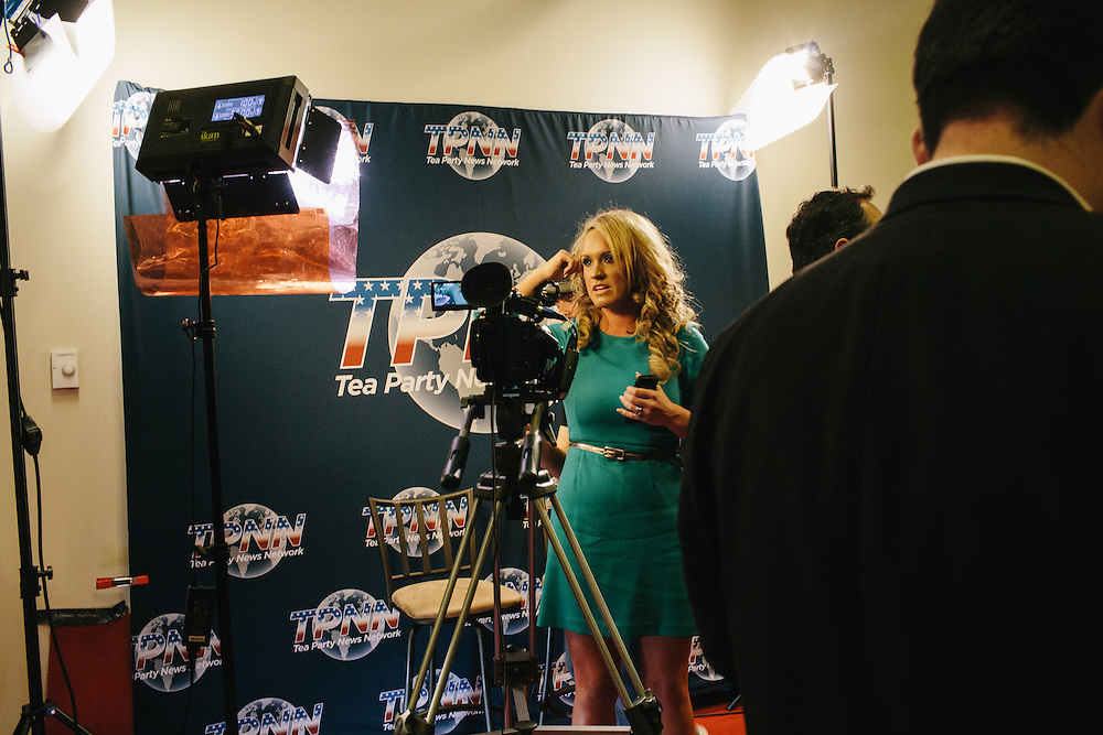 Scottie Hughes, center, the news director for the Tea Party News Network finishes a segment for the network during day two of the Conservative Political Action Conference (CPAC) at the Gaylord National Resort & Convention Center in National Harbor, Md.