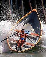ME.Lifeguard.Dory.0716.KC--Huntington Beach--California Surf Lifesaving Association--Bob Burnside, 66, a retired captain from Los Angeles competes in the international Ironman competion steers his dory into a wave in a part from the all day competion..Mandatory Credit: Kevin P. Casey/The LA Times