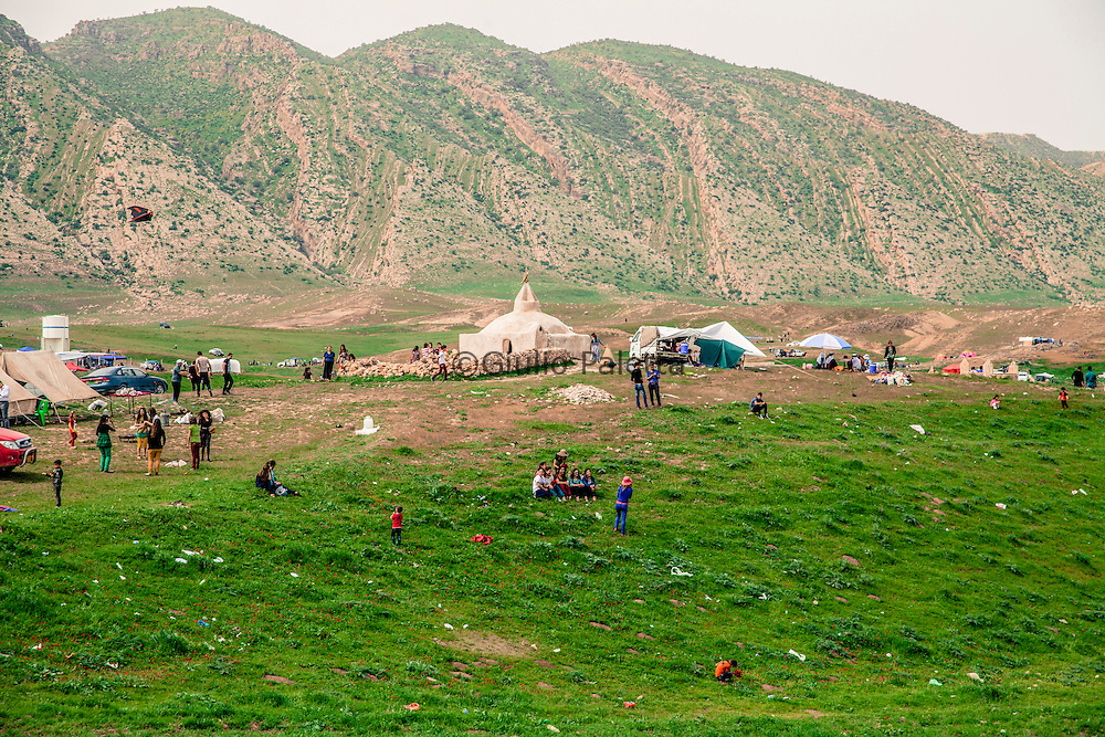 Prayers and ceremonies during the annual spring celebrations dedicated to the shrine of Mohamed Rashan where many Yazidi's families, each from different villages, pay their visit to the servant of the temple and his family offering him food and donations. This is one of the most important celebrations of Yazidis. They camp together in wide grass fields, pray and dance typical music played by the Kawals using the 2 typical instruments, the Daf (frame drum) and the Shabbabi (flute)
