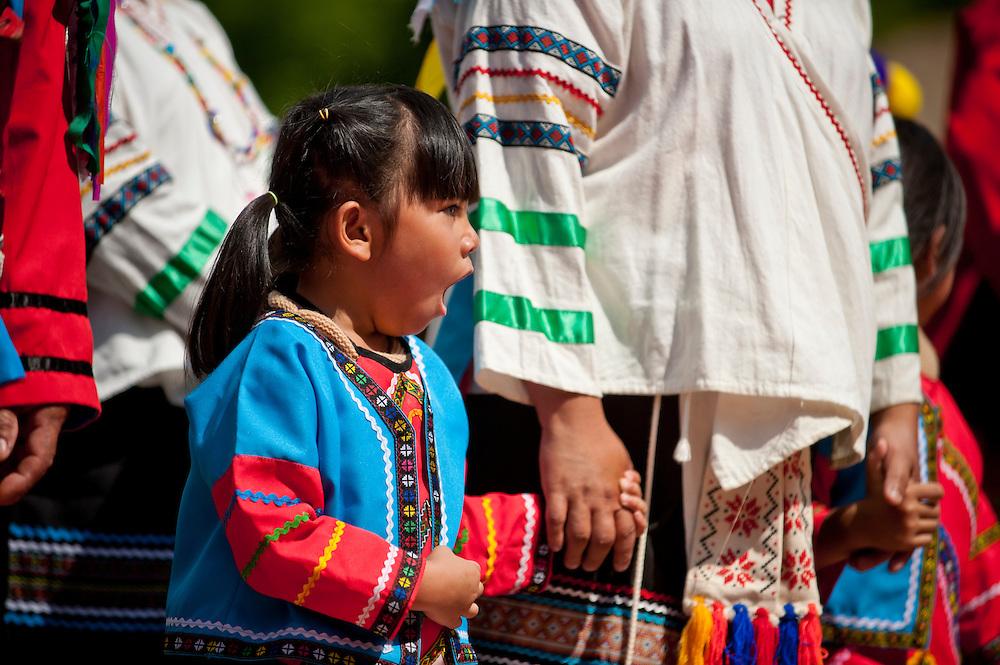 Zhou girl yawna at Annual Bunun Ear Festival, Maya village, Ming Chuan, Namasiya Township, Kaoshiung County, Taiwan