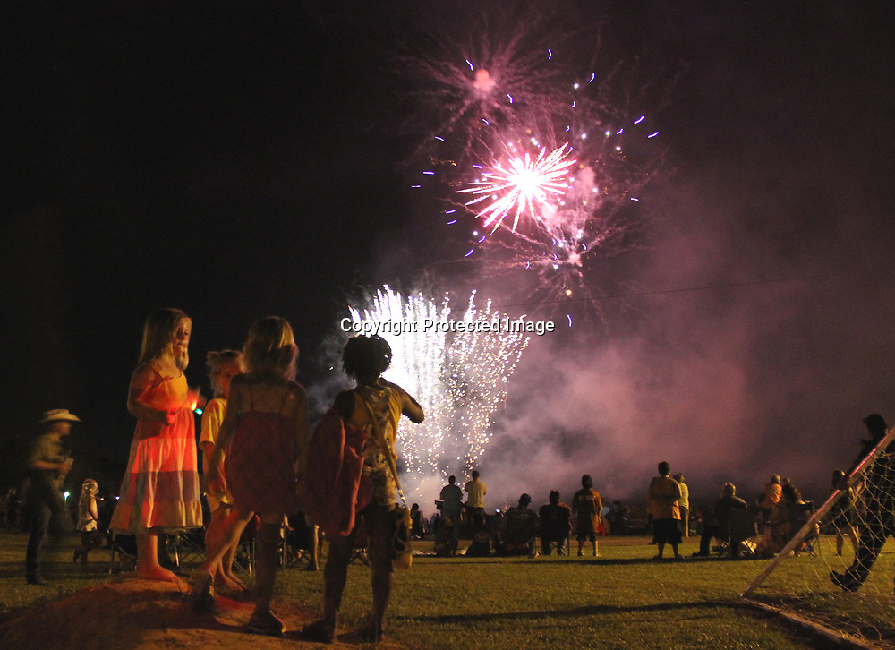 RAY VAN DUSEN/MONROE JOURNAL FILE <br /> A group of girls mingle and watch last year's fireworks show sponsored by the Friends of Nettleton. This year, Nettleton and Smithville will host Fourth of July fireworks shows.