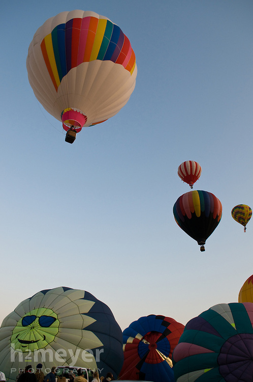 Pilots and crews ready their balloons for flight at dawn on the first day of the 2008 Montague Balloon Fair near Mount Shasta, California.