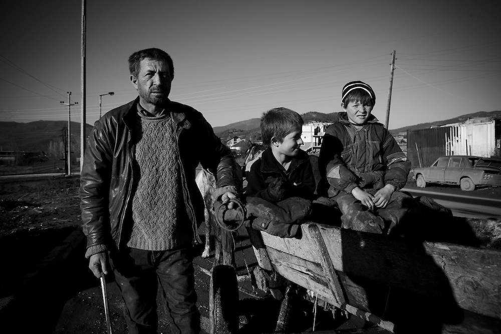 (01/12/2007) A Kosovo Albanian family who have spent a day collecting scrap to sell on to a junkyard, on the main road between Pristina and Mitrovica, Kosovo. The father of the family earnt 11 euros for the days work which had to help support his ten children. (photo: Greg Funnell)