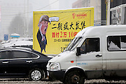 SHENYANG, CHINA - FEBRUARY 22: <br /> <br /> Real Estate Ad Posts, Donald Trump's Cartoon Image In Shenyang<br /> <br /> People pass by a real estate ad poster with a cartoon image of American president Donald J. Trump along the road on February 22, 2017 in Shenyang, Liaoning Province of China. <br /> ©Exclusivepix Media