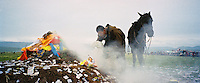 China, Xiahe, 2005. The strongest young riders and the fastest horses are chosen for a single wild race at this nomad ceremony near the Sanke Pass in Gansu Province..