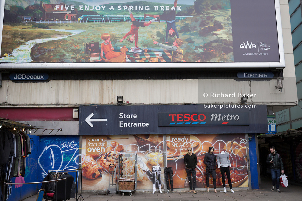 Mannequins stand beneath a country idyllic picnic scene in a railway billboard ad at Elephant and Castle shopping centre, on 29th March, 2018 in London, England.