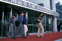 CHINA SHANGHAI PUDONG MAY99 - Brokers leave the Shanghai Stock Exchange through the main entrance...jre/Photo by Jiri Rezac..© Jiri Rezac 1999..Contact: +44 (0) 7050 110 417.Mobile:  +44 (0) 7801 337 683.Office:  +44 (0) 20 8968 9635..Email:   jiri@jirirezac.com.Web:     www.jirirezac.com..© All images Jiri Rezac 1999 - All rights reserved.