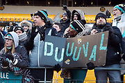 A Jacksonville Jaguars fans holds up a Duuuval sign as fans celebrate during the NFL 2018 AFC Divisional playoff football game against the Pittsburgh Steelers, Sunday, Jan. 14, 2018 in Pittsburgh. The Jaguars won the game 45-42. (©Paul Anthony Spinelli)