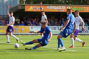 AFC Wimbledon midfielder Callum Reilly (33) shoots at goal during the EFL Sky Bet League 1 match between AFC Wimbledon and Shrewsbury Town at the Cherry Red Records Stadium, Kingston, England on 14 September 2019.