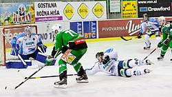 Bostjan Golicic (HDD Tilia Olimpija, #71) vs Adam Munro (SAPA Fehervar AV19, #51) during ice-hockey match between HDD Tilia Olimpija and SAPA Fehervar AV19 at second match in Quarterfinal  of EBEL league, on Februar 21, 2012 at Hala Tivoli, Ljubljana, Slovenia. HDD Tilia Olimpija won 2:1 in OT. (Photo By Matic Klansek Velej / Sportida)