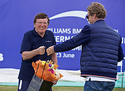 LIVERPOOL, ENGLAND - Sunday, June 23, 2019: Line judge Colin xxxx is presented with flowers by Tournament Director Anders Borg during the Men's Final on Day Four of the Liverpool International Tennis Tournament 2019 at the Liverpool Cricket Club. (Pic by David Rawcliffe/Propaganda)