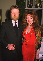 The EARL & COUNTESS OF BURFORD heir to the Duke of St.Albans, at a party in London on 23rd March 1998.MGH 27