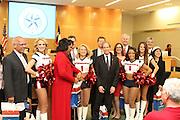 Houston Texans cheerleaders attend a school board meeting.