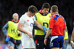Owen Farrell of England is treated for an injury to his wrist - Mandatory byline: Patrick Khachfe/JMP - 07966 386802 - 04/02/2017 - RUGBY UNION - Twickenham Stadium - London, England - England v France - RBS Six Nations Championship 2017.