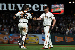 SAN FRANCISCO, CA - AUGUST 13: Buster Posey #28 of the San Francisco Giants celebrates with Will Smith #13 after the game against the Oakland Athletics at Oracle Park on August 13, 2019 in San Francisco, California. The San Francisco Giants defeated the Oakland Athletics 3-2. (Photo by Jason O. Watson/Getty Images) *** Local Caption *** Buster Posey; Will Smith