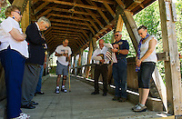 Evelyn Firth and Bill Firth Commander and Auxiliary District 7, Bob Stevens, Post 58 Commander Rich Stanley, Vice Commander David Schroth and Martha Bracy offer a prayer during the VFW Post 58 flag retirment ceremony at Belmont's covered bridge Saturday afternoon.  (Karen Bobotas/for the Laconia Daily Sun)