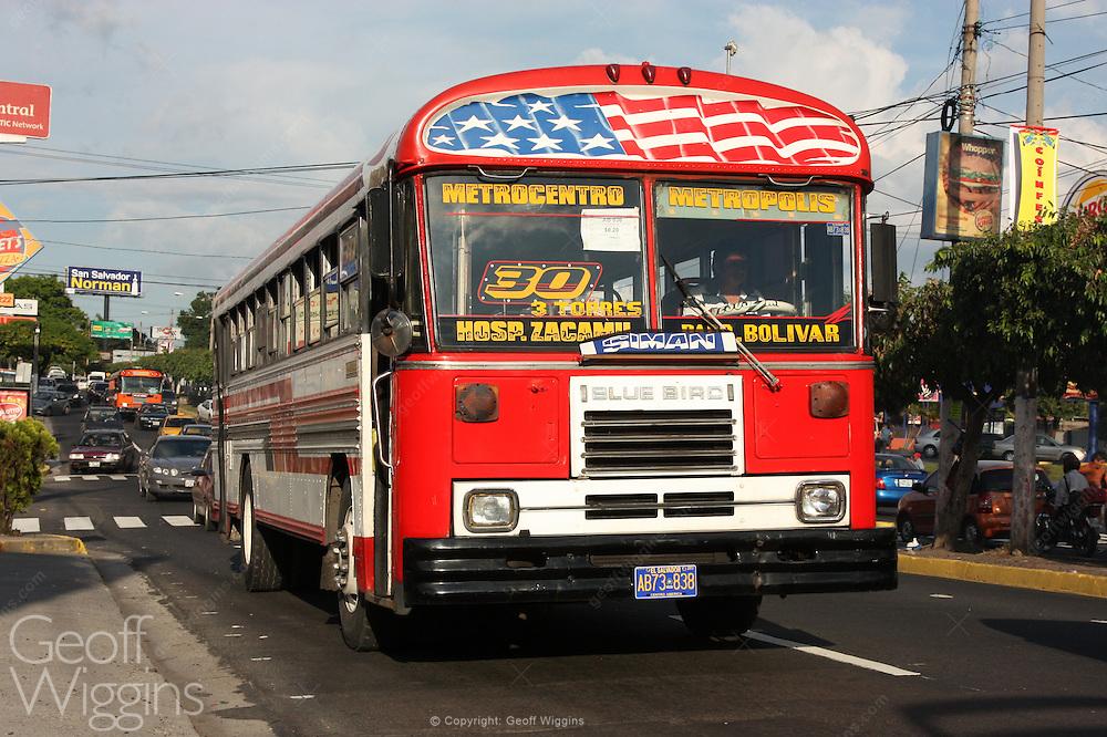 San Salvador city Bus races through rush hour traffic. El Salvador