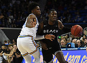 Nov 6, 2019; Los Angeles, CA, USA; Long Beach State 49ers guard Drew Cobb (3) is defended by UCLA Bruins guard David Singleton (34) in the first half  at Pauley Pavilion.