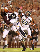 Sept 18, 2010; College Station, TX, USA; Texas A&M Aggies wide receiver Terrence McCoy (11) catches a touchdown pass over FIU Golden Panthers cornerback Dezariah Johnson (29) and  cornerback Jonathan Cyprien (25) during the second half at Kyle Field. The Aggies won 27-20. Mandatory Credit: Thomas Campbell-US PRESSWIRE
