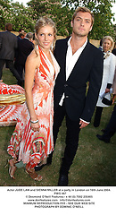aActor JUDE LAW and SIENNA MILLER at a party in London on 16th June 2004.<br /> PWG 467