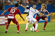 FRISCO, TX - JULY 13:  Javier Morales #11 of Real Salt Lake controls the ball while defended by Stephen Keel #22 and David Ferreira #10 of FC Dallas on July 13, 2013 at FC Dallas Stadium in Frisco, Texas.  (Photo by Cooper Neill/Getty Images) *** Local Caption *** Javier Morales; Stephen Keel