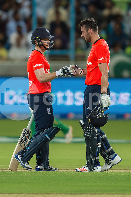 England Captain Eoin Morgan (left ) and James Vince of England (right) during the 1st International T20 Series match between Pakistan and England at Dubai International Cricket Stadium, Dubai, UAE on 26 November 2015. Photo by Grant Winter.