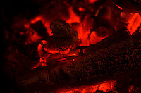 Close-up of red-hot embers in the fire.