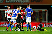 Brentford's Midfielder Nico Yennaris reacts after Brentford's Defender Yoann Barbet is fouled*** during the EFL Sky Bet Championship match between Brentford and Birmingham City at Griffin Park, London, England on 2 October 2018.