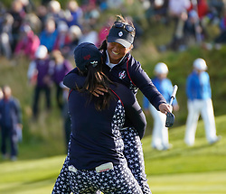 Auchterarder, Scotland, UK. 15 September 2019. Sunday final day at 2019 Solheim Cup on Centenary Course at Gleneagles. Pictured; Megan Khang of Team USA is lifted off her feet by Angel Lin to celebrate Khang's win on the 18th hole over Charley Hull . Iain Masterton/Alamy Live News